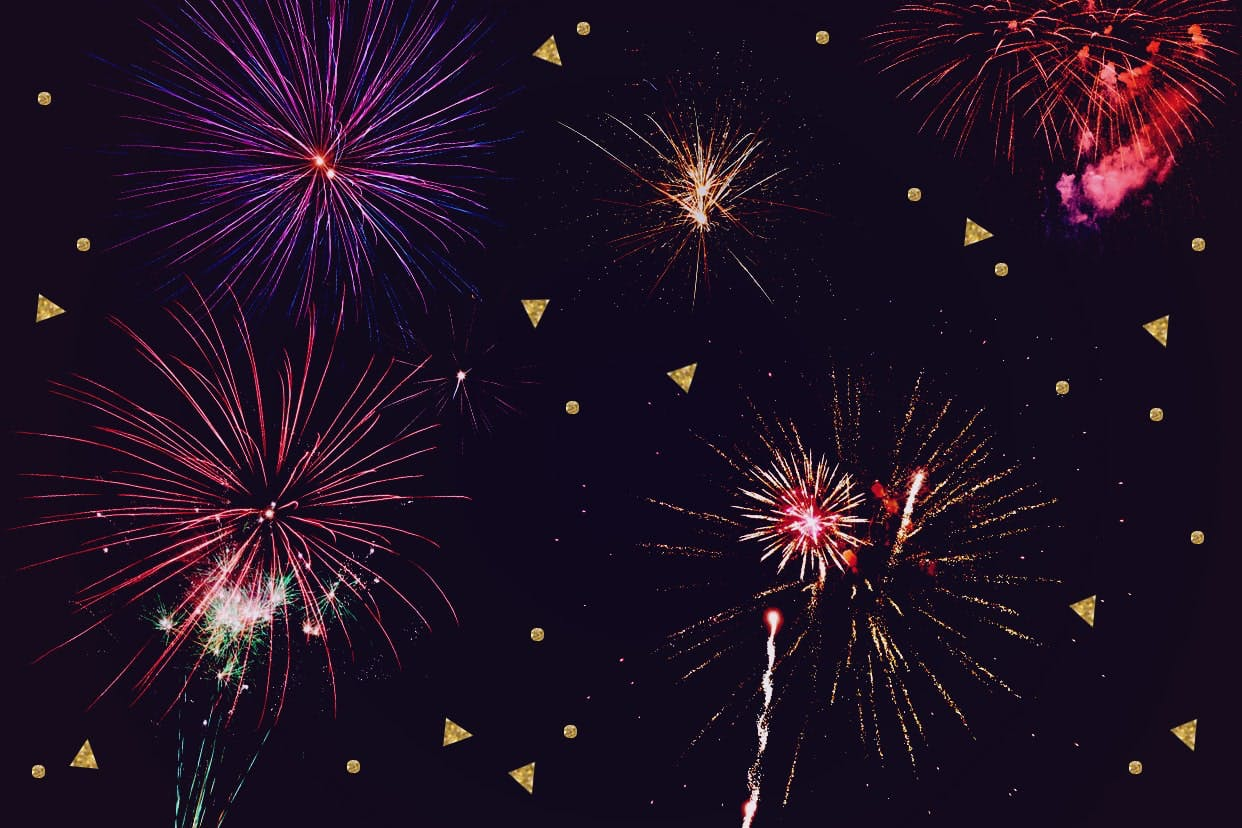 Fireworks and confetti on a black background.