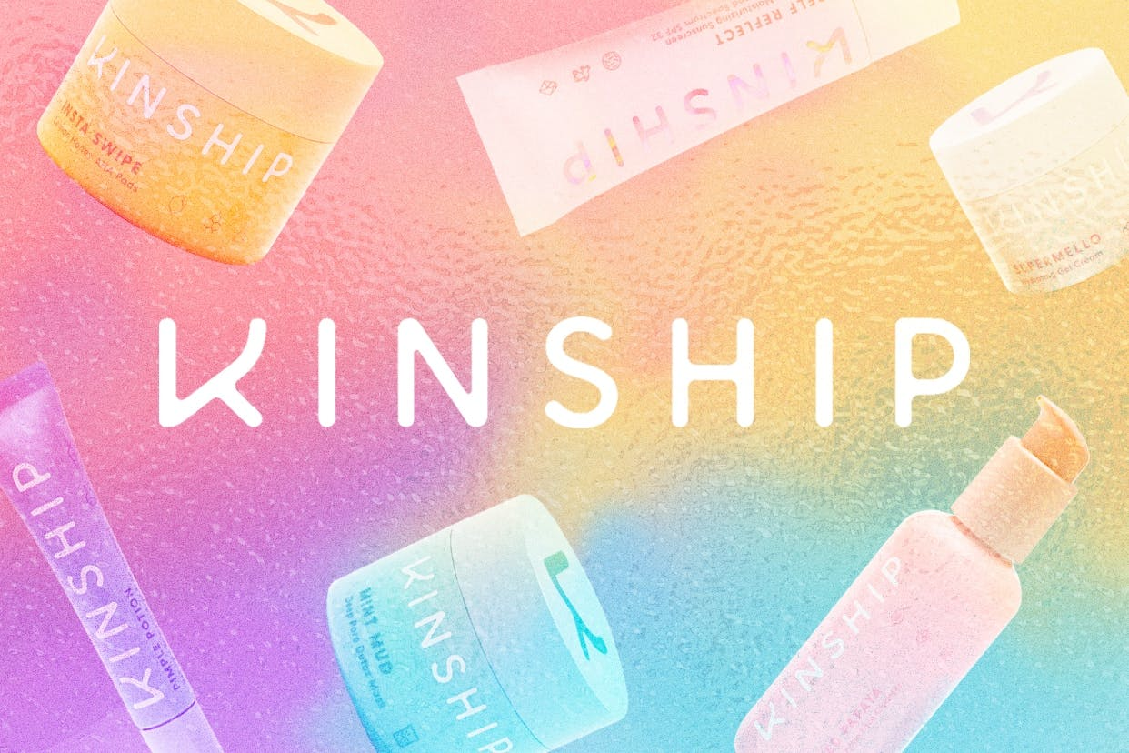 Kinship skincare products on a rainbow background