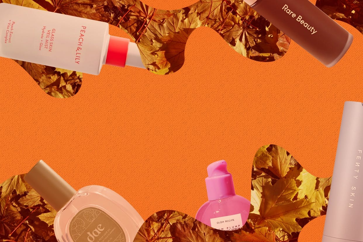 Fall 2020 beauty products on an orange background with leaves