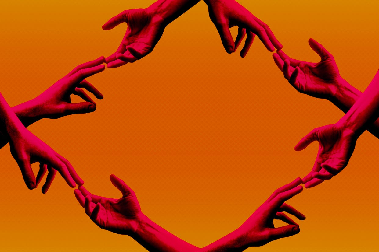 hands touching in solidarity on an orange background