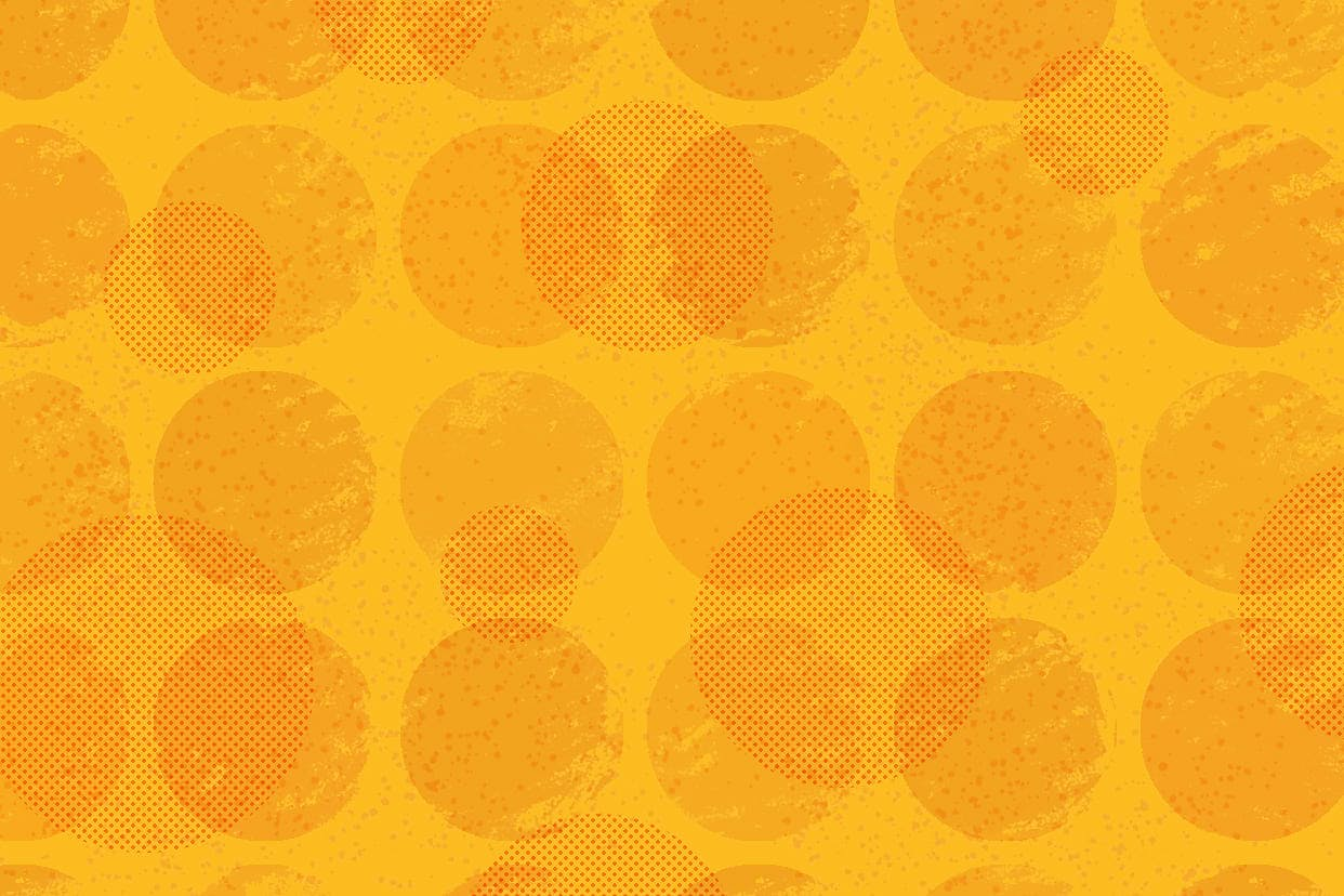 Bright yellow background covered in orange spots