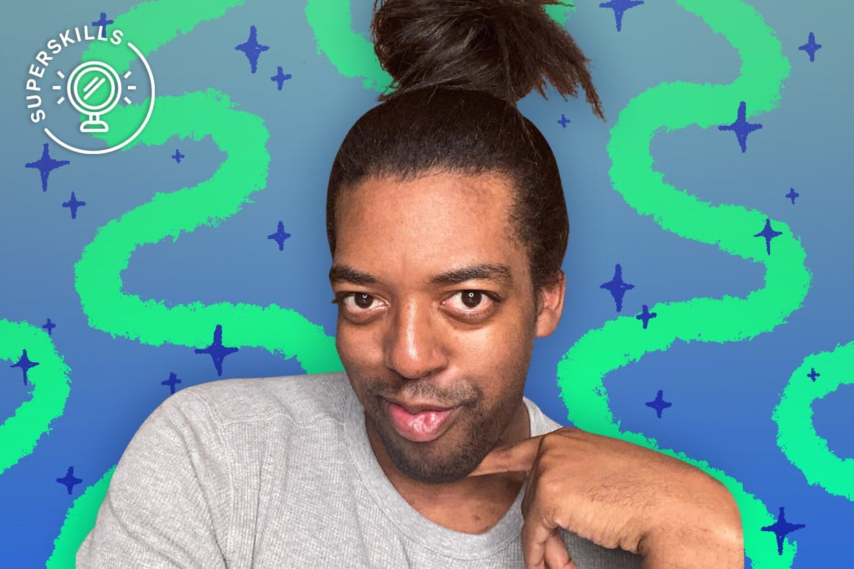 Karl T. Payton poses with his messy bun on a squiggly background.