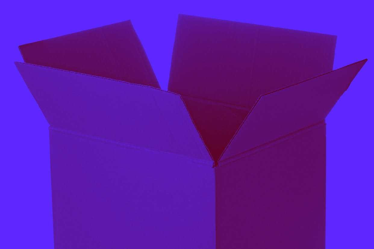 Cardboard box being opened on a purple background