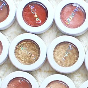 ColourPop logo across various eyeshadows