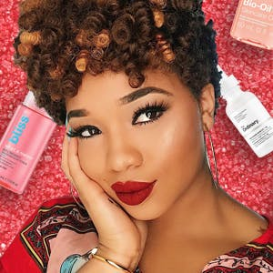 Nneoma Okorie surrounded by her favorite beauty products