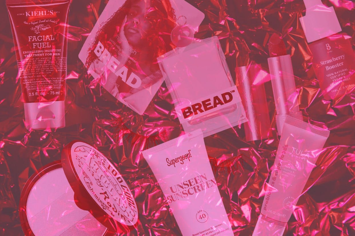 Beauty products on a gradient pink background